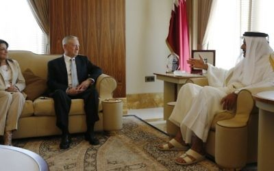Qatar's Emir Sheikh Tamim bin Hamad al-Thani, right, welcomes US Defense Secretary James Mattis, center, and  US ambassador to Qatar, Dana Shell Smith, left, at the Prince's Sea Palace residence in Doha, on April 22, 2017. (AFP Photo/Pool/Jonathan Ernst)