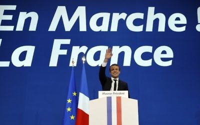 French presidential election candidate for the En Marche ! movement Emmanuel Macron delivers a speech at the Parc des Expositions in Paris, on April 23, 2017, after the first round of the Presidential election. (AFP PHOTO / Patrick KOVARIK)