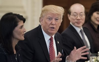 US Ambassador to the UN Nikki Haley (L) and China's Ambassador to the UN Liu Jieyi (2R) listen while US President Donald Trump (2L) speaks before a working lunch with UN Security Council member nations in the State Dining Room of the White House April 24, 2017, in Washington, DC. (AFP PHOTO / Brendan Smialowski)