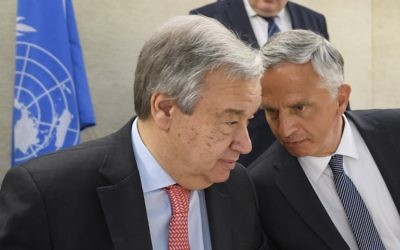 UN Secretary-General Antonio Guterres, listens to Swiss Foreign Minister Didier Burkhalter at the opening of a high-level conference at the United Nations Office in Geneva, April 25, 2017. (AFP/Fabrice COFFRINI)