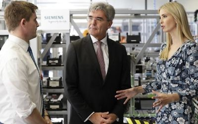 First Daughter and adviser to the US President Ivanka Trump talks with the chairman of Siemens Joe Kaeser (middle) and a trainee (L) during a visit of the Siemens Technik Akademie in Berlin on April 25, 2017. (Michael Sohn/AFP)