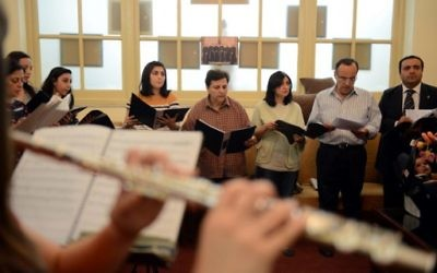 Saint Joseph's Roman Catholic church choir rehearses in a hall beside the church in the Egyptian capital Cairo on April 19, 2017, ahead of Pope Francis' visit. (AFP Photo/Mohamed El-Shahed)