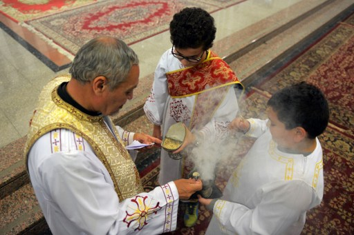 A priest burns incense during Sunday Mass at Saint Mary's church in the Egyptian capital Cairo on April 23, 2017, ahead of Pope Francis' visit. (AFP Photo/Mohamed El-Shahed)