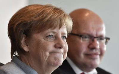 German Chancellor Angela Merkel (L) and German Chief of Staff Peter Altmaier attend the weekly Cabinet Meeting in Berlin, on April 26, 2017. / AFP PHOTO / John MACDOUGALL