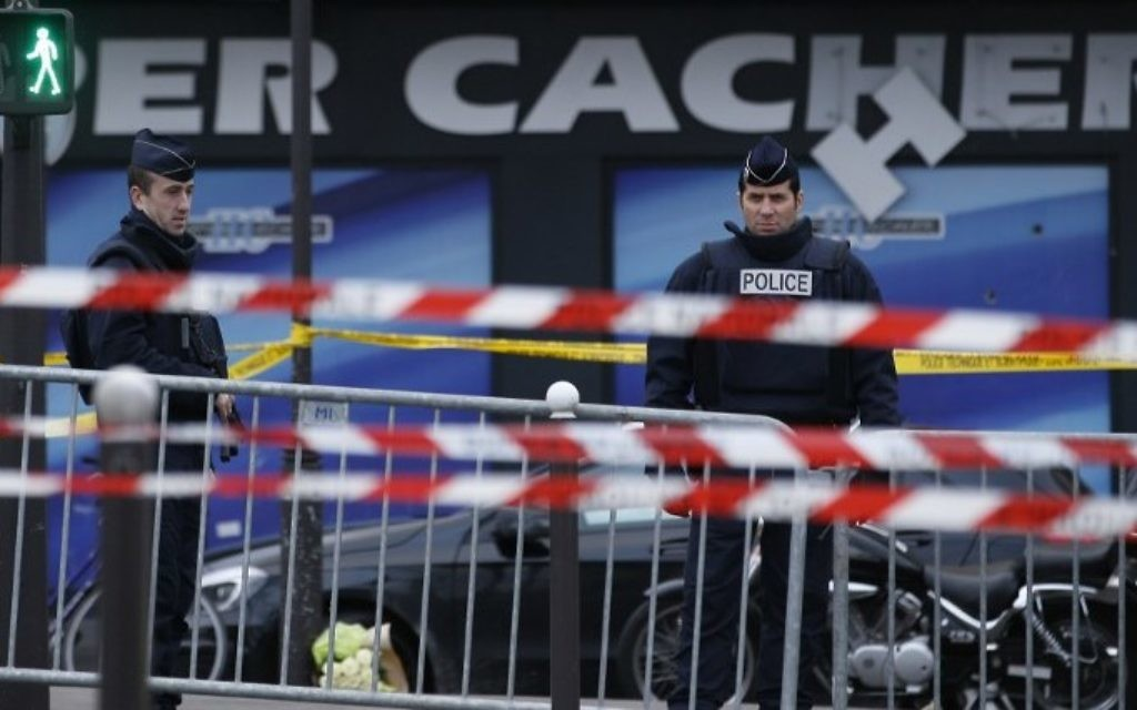 This file photo taken on January 10, 2015 shows French police officers standing guard in front of a kosher grocery store in Porte de Vincennes, eastern Paris, a day after four people were killed at the Jewish supermarket by jihadist gunman Amedy Coulibaly during a hostage-taking. (Kenzo Tribouillard/AFP)