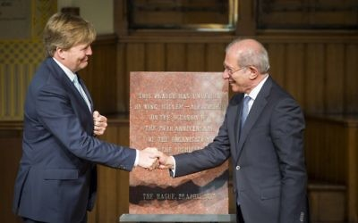 Dutch King Willem-Alexander, shakes hands with OPCW Turkish director-general Ahmet Uzumcu, after unveiling a commemorative plaque during a ceremony marking the 20th anniversary of the founding of the global chemical arms watchdog, the Organization for the Prohibition of Chemical Weapons, in The Hague, April 26, 2017. (AFP/ANP/Lex van Lieshout)