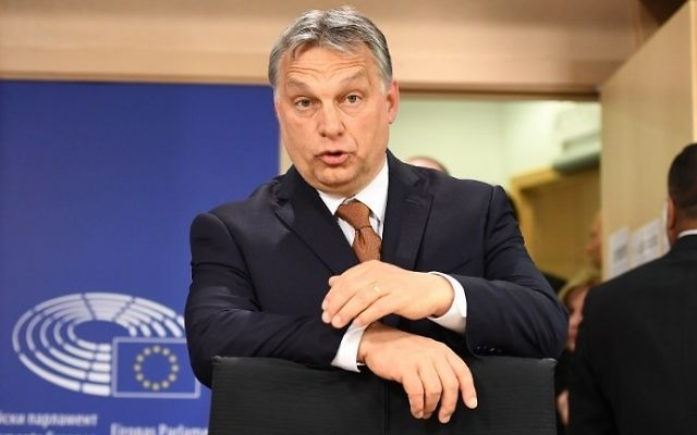 Hungary's Prime Minister Viktor Orban arrives to address a press conference after attending a European Parliament plenum session on the situation in Hungary, on April 26, 2017 in Brussels. (AFP Photo/Emmanuel Dunand)