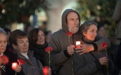 People hold candles during a ceremonial march to commemorate the 80th aniversary of the bombing the Spanish northern Basque village of Gernika on April 26, 2017.  (Ander Gillenea/AFP)
