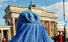 A woman wearing a burka during a demonstration against the German Bundeswehr army's deployment in Afghanistan in front of the Brandenburg Gate in Berlin on February 20, 2010. (AFP/David  Gannon)