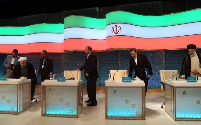 Iranian presidential candidates, left to right, Hassan Rouhani, Mohammad Baqer Qalibaf, Eshaq Jahangiri and Ebrahim Raisi attend a live debate on state TV in Tehran on April 28, 2017. (AFP/Jamejamonline/Mehdi Dehghan)