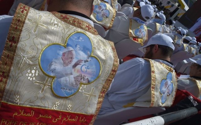Egyptian worshippers wear clothing celebrating the visit of Pope Francis to their country during a mass by the pontiff on April 29, 2017 at a stadium in Cairo. (AFP PHOTO / Andreas SOLARO)