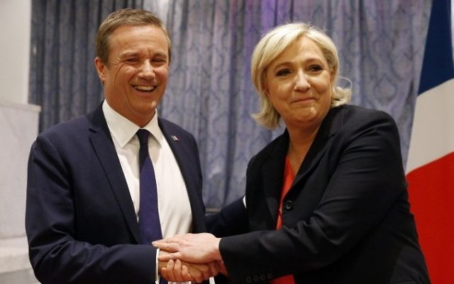 Former French presidential election candidate for the right-wing Debout la France (DLF) party Nicolas Dupont-Aignan (L) and French presidential election candidate for the far-right Front National (FN) party Marine Le Pen, shake hands at the end of a joint statement at FN headquarters in Paris, on April 29, 2017. (AFP/Geoffroy van der Hasselt)