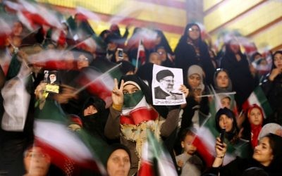 Supporters of Iranian presidential candidate Ebrahim Raisi attend a campaign rally in the capital Tehran on April 29, 2017. (AFP/Atta Kenare)