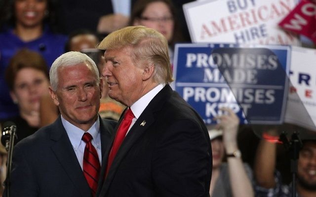 """US President Donald Trump (R) is introduced by Vice President Mike Pence (L) during a """"Make America Great Again Rally"""" at the Pennsylvania Farm Show Complex Expo Cent,er April 29, 2017, in Harrisburg, Pennsylvania. (Alex Wong/Getty Images/AFP)"""