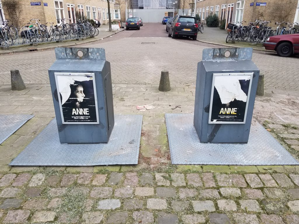 Posters for the play 'Anne' about the diarist Anne Frank, displayed near the Amsterdam apartment building in which the Frank family lived until 1942 (Matt Lebovic/The Times of Israel)