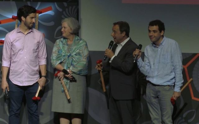 The Suskind family accepting their prize at the Tribeca Disruptive Innovation Awards. From left, Walter, Cornelia, Ron and Owen. (Vimeo/screenshot)