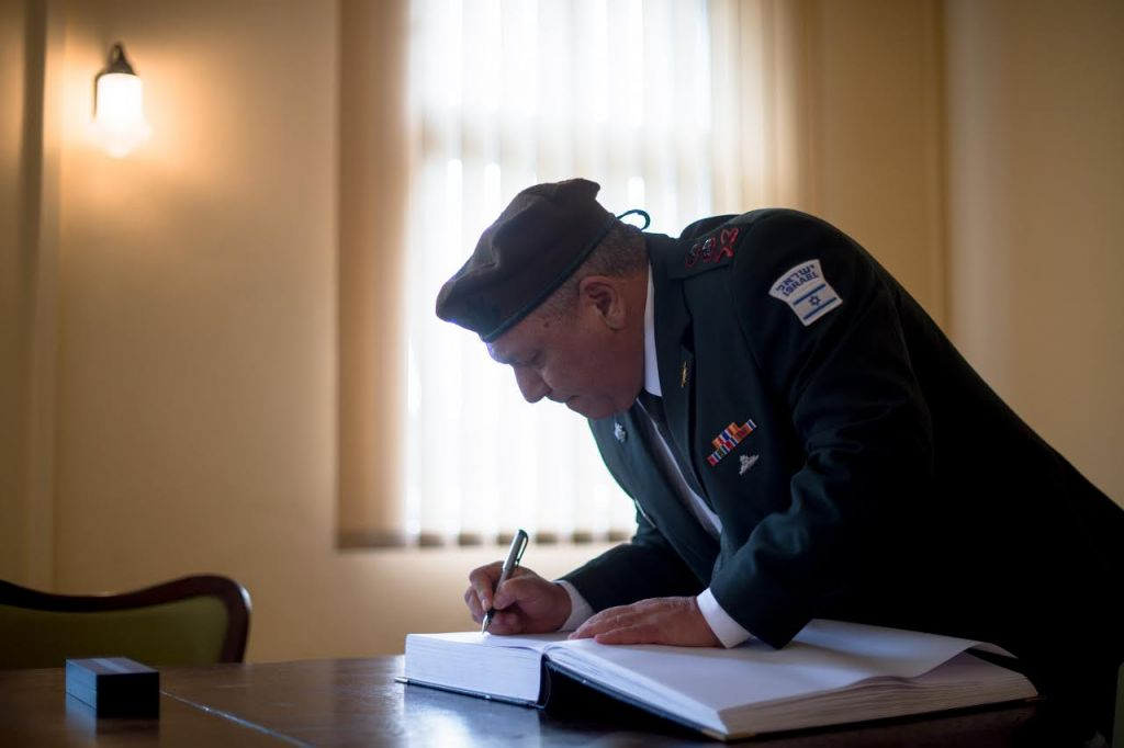 IDF Chief Lt. Gen. Gadi Eisenkot signs the guest book at the Auschwitz-Birkenau concentration camp in Poland on April 23, 2017, ahead of Holocaust Remembrance Day. (IDF Spokesperson's Unit)