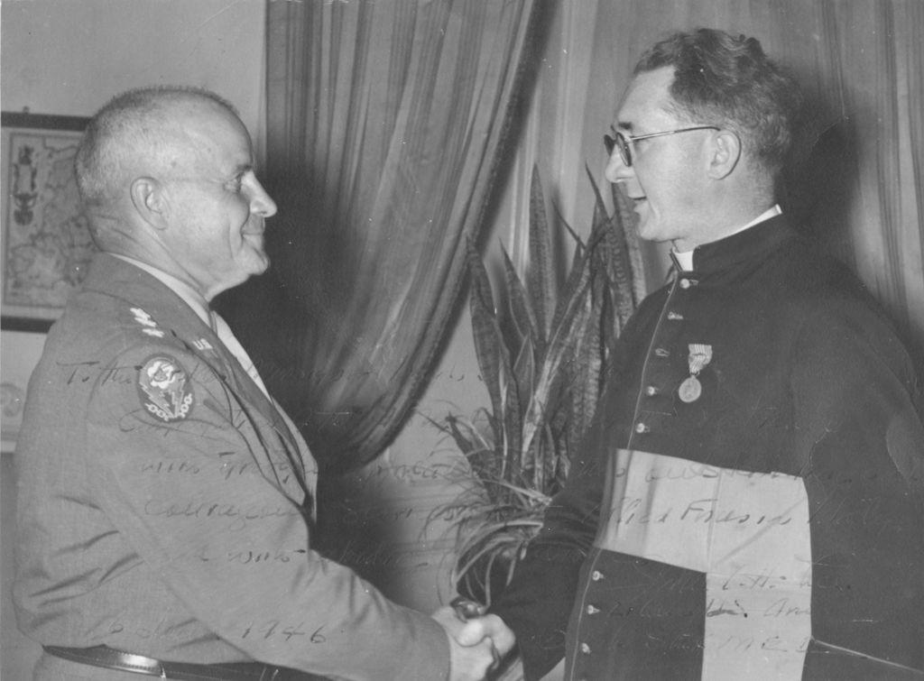 Lieutenant General John C.H. Lee presenting the US Medal of Freedom to Monsignor Hugh O'Flaherty. (Courtesy/Memorial Society)