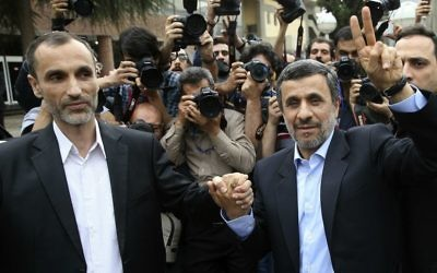 Former Iranian President Mahmoud Ahmadinejad, right, and his close ally Hamid Baghaei flash the victory sign as they arrive at the Interior Ministry to register their candidacy for the upcoming presidential elections, in Tehran, Iran, April 12, 2017. (AP Photo/Ebrahim Noroozi)
