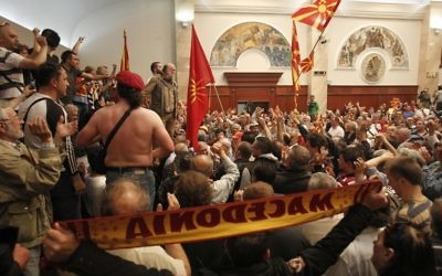 Protesters enter into the parliament building in Skopje, Macedonia, Thursday, April 27, 2017. (AP/Boris Grdanoski)