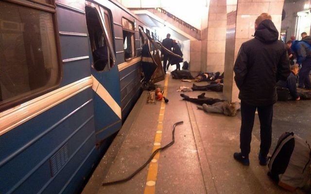 Blast victims lie near a subway train hit by a explosion at the Tekhnologichesky Institut subway station in St. Petersburg, Russia, on April 3, 2017. (AP/DTP&ChP St. Peterburg via AP)