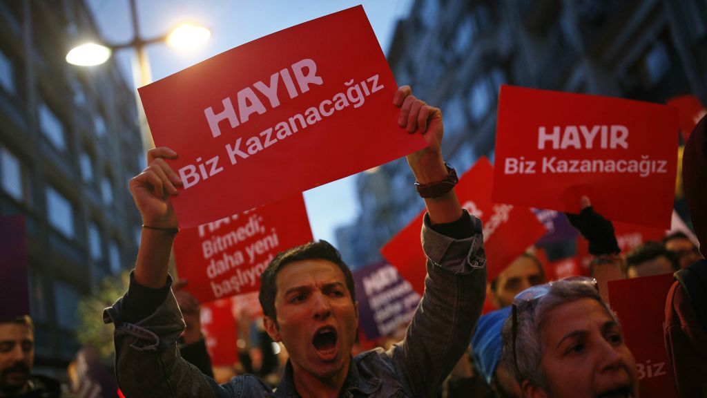 Supporters of the 'no' vote protest in Istanbul, against the referendum outcome, Monday, April 17, 2017. The placards reads in Turkish: 'No we will win'. (AP Photo/Emrah Gurel)