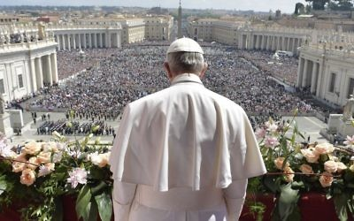 Pope Francis addresses the crowd prior to delivering his Urbi et Orbi (to the city and to the world) message from the main balcony of St. Peter's Basilica, at the Vatican, Sunday, April 16, 2017. (L'Osservatore Romano/Pool Photo via AP)
