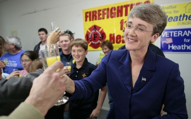 Rep. Heather Wilson, R-N.M., raises her glass of orange juice in celebration after she declared her victory in the 1st Congressional District race at her campaign headquarters late Thursday night, Nov. 9, 2006, in Albuquerque, N.M. (AP Photo/Jake Schoellkopf)
