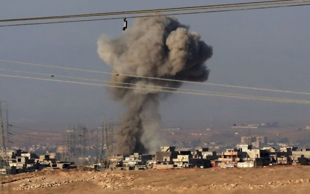 Illustrative: Smoke rises after an airstrike by US-led coalition warplanes against Islamic State positions in western Mosul, Iraq, Saturday, February 25, 2017. (AP Photo/ Khalid Mohammed)