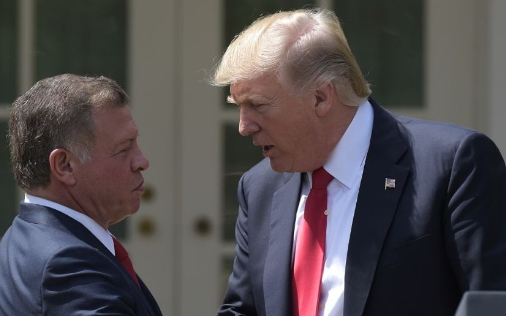 US President Donald Trump and Jordan's King Abdullah II shake hands during a news conference in the Rose Garden of the White House in Washington, Wednesday, April 5, 2017. (AP Photo/Susan Walsh)