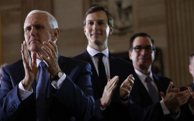 From left, US Vice President Mike Pence, White House senior adviser Jared Kushner and Treasury Secretary Steve Mnuchin applaud on Capitol Hill in Washington, Tuesday, April 25, 2017, where US President Donald Trump spoke at the United States Holocaust Memorial Museum's National Days of Remembrance ceremony. (AP Photo/Pablo Martinez Monsivais)