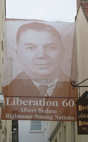A banner of Albert Bedane flying in St. Helier on the 60th anniversary of Jersey's liberation from the Nazis. (Public domain)