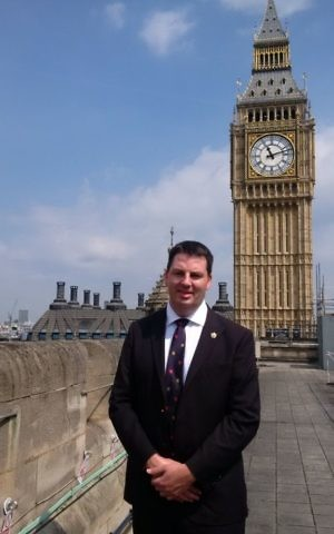 Andrew Percy stands next to Big Ben in London. (Courtesy)
