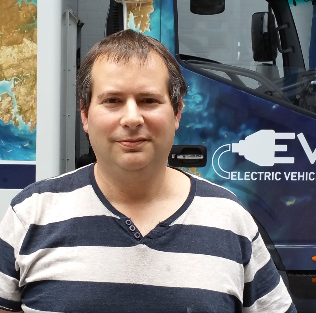 Tevva Motors' Asher Bennett with one of his trucks (Courtesy)