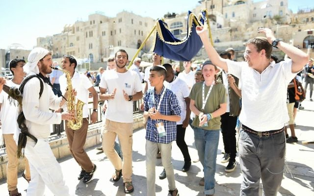 Some of the orphaned bar mitzvah boys being danced to the Western Wall for the Colel Chabad celebration (Courtesy Israel Bardugo)