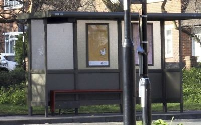 A general view of the bus stop in Croydon, south London, Monday April 3, 2017, where a 17-year old Iranian-Kurdish asylum seeker was attacked by a group of people in a suspected hate attack on Friday March 31. (Georgina Stubbs/PA via AP)