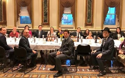 Members of US President Donald Trump's staff participate in a Passover Seder in the Indian Treaty Room of the Eisenhower Executive Office Building, on the White House grounds. Trump himself did not attend the dinner held on April 10, 2017. (Courtesy)
