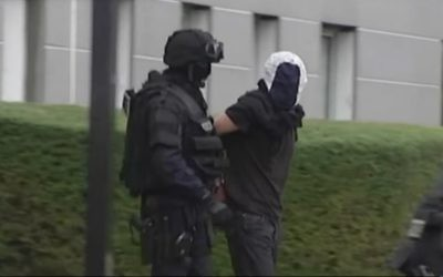 Police arrest a suspected member of the Cannes-Torcy jihadist terror ring (screen capture: YouTube)
