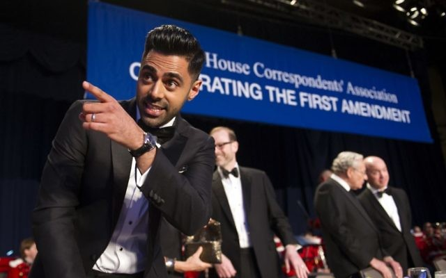 The Daily Show correspondent Hasan Minhaj stands at the head table during the White House Correspondents' Dinner in Washington, April 29, 2017. (AP Photo/Cliff Owen)