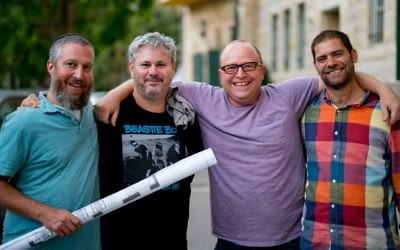 The four owners of Jerusalem restaurant Crave, from left, Tzvi Maller, Chef Todd Aarons, James Oppenheim and Yoni Van Leeuwen (Courtesy David Zimand)