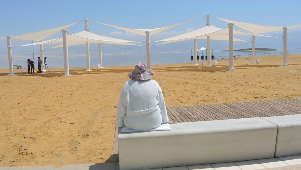 A woman enjoys the new promenade in Ein Boqek on April 3, 2017. (Melanie Lidman/Times of Israel)