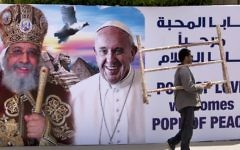 A billboard with a picture of Egyptian Coptic Pope Tawadros II, left, welcomes Pope Francis, at St. Mark's Cathedral in Cairo, Egypt, Thursday, April 27, 2017. (Amr Nabil/AP)