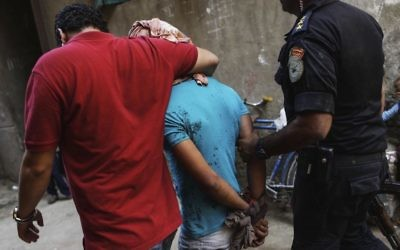 In this Sept. 26, 2013 file photo, Egyptian security forces detain a man in Giza's Kerdasa district, south of Cairo, Egypt. (AP Photo/Eman Helal, File)