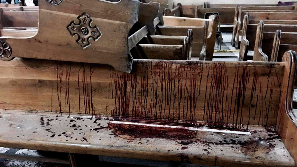 Blood stains pews inside the St. George Church after a suicide bombing in the Nile Delta town of Tanta, Egypt, Sunday, April 9, 2017. (AP Photo/Nariman El-Mofty)