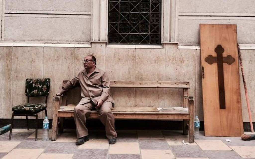 A man sits on a bench outside a church after a bomb attack in the Nile Delta town of Tanta, Egypt, Sunday, April 9, 2017. (AP Photo/Nariman El-Mofty)