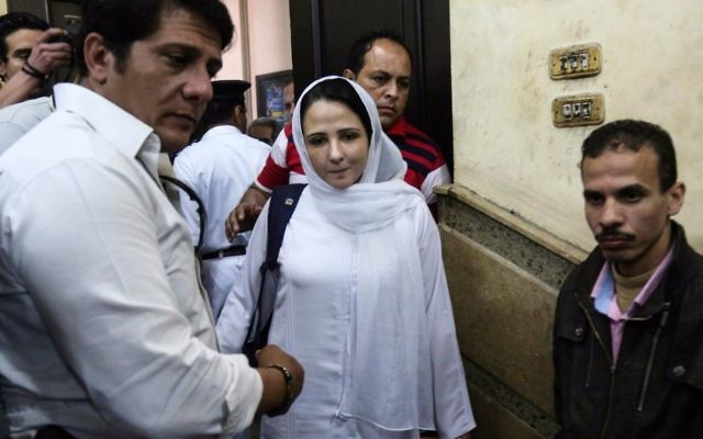 Aya Hijazi, center, a dual US-Egyptian citizen, is acquitted by an Egyptian court after nearly three years of detention over accusations related to running a foundation dedicated to helping street children, in Cairo, Egypt, April 16, 2017. (AP Photo/Mohamed el Raai)