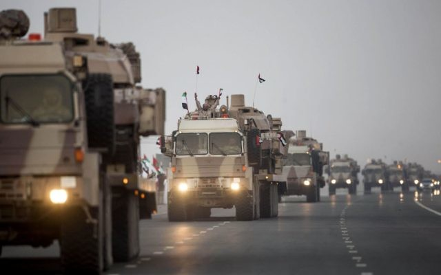 In this Nov. 7, 2015 file photo, made available by the Emirates News Agency, WAM, a convoy of UAE military vehicles and personnel travels from Al Hamra Military Base to Zayed Military City, marking the return of the first batch of UAE Armed Forces military personnel from Yemen, in Abu Dhabi, United Arab Emirates. (Ryan Carter-Crown Prince Court - Abu Dhabi/WAM via AP)