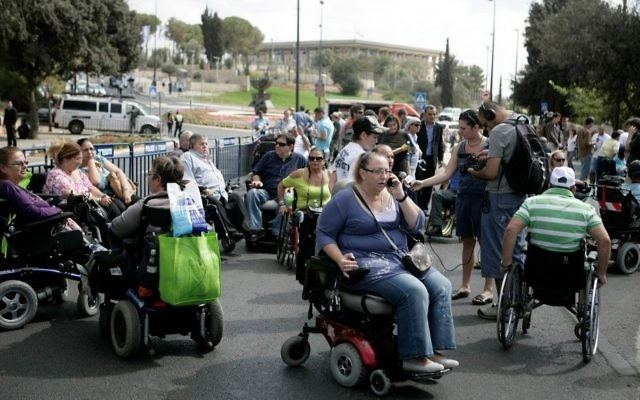Illustrative: A demonstration outside the offices of Welfare and Finance Ministries attended by hundreds of disabled people in Jerusalem on Oct 25, 2010. (Abir Sultan/Flash 90)