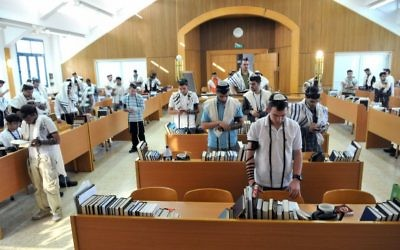 Illustrative: Religious Zionist students praying at a hesder yeshiva. (The hesder program which combines advanced Talmudic studies with military service in the Israel Defense Forces, usually within a Religious Zionist framework.) (Yossi Zeliger/Flash90)