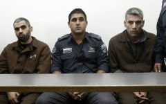 Ayad Fatafta and Kifah Ghanimat, convicted of murdering Kristine Luken and injuring Kay Wilson in a stabbing attack in the Jerusalem Forest on December 18, 2010, seen at the Jerusalem District Court on November 24, 2011. (Uri Lenz/Flash90)